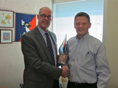 Jeff Sampson, Control Instruments Corporation Executive Client Relations Manager, presenting the first annual Control Instruments Excellence in Safety award to Tim Salaba, Division Engineering Manager for 3M Company Process Information & Control Solutions.
